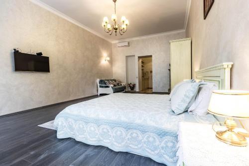 Кровать или кровати в номере Домінікана
