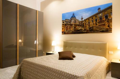 A bed or beds in a room at Palazzo Caltagirone Apartments