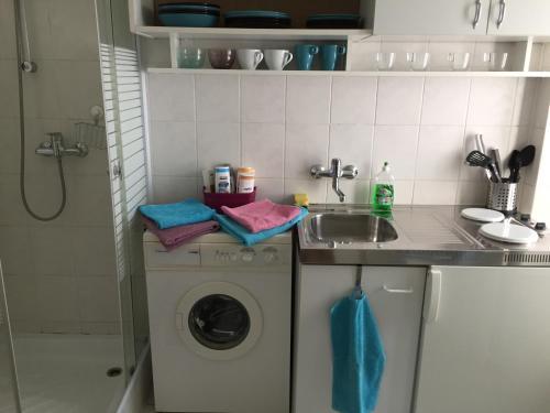 A kitchen or kitchenette at Jazz Apartment