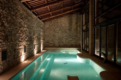 The swimming pool at or near Casa Zorzi