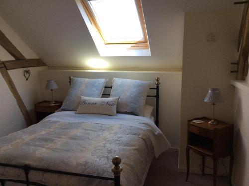 Un ou plusieurs lits dans un hébergement de l'établissement Le Studio Vert