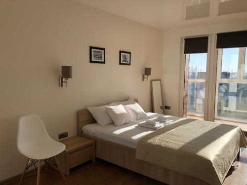 A bed or beds in a room at Central Apartment Sea View