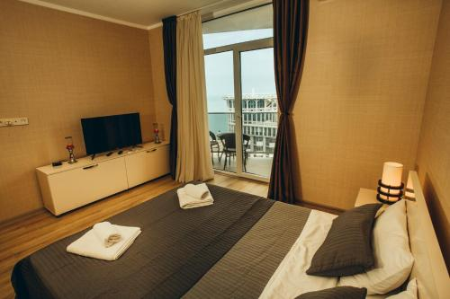 A bed or beds in a room at Laguna Orbi Sea Towers