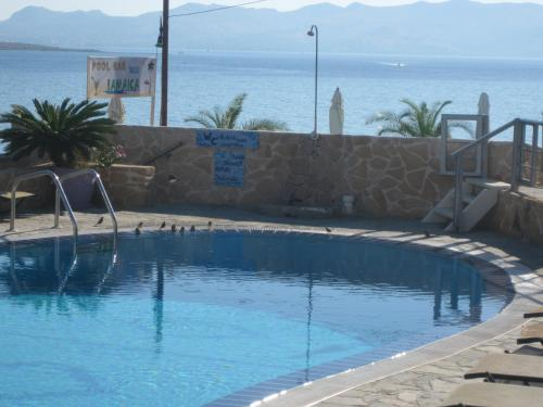 The swimming pool at or near Hotel Milos