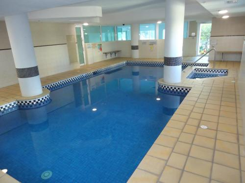 The swimming pool at or near The Crest Apartments