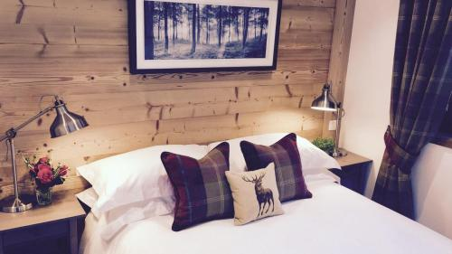 A bed or beds in a room at Grand Paradis