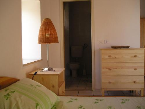 A bed or beds in a room at Apartments Pavla