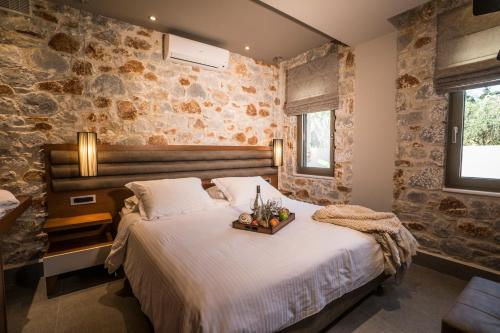 A bed or beds in a room at AA Luxury Villas