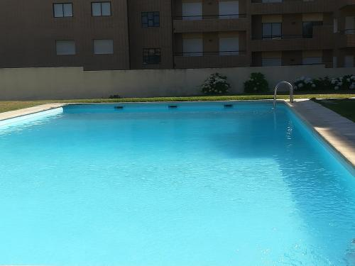 The swimming pool at or near Vila Cha Apartment