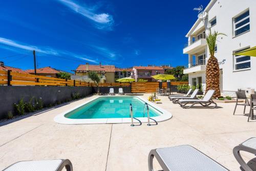 The swimming pool at or near Villa Diadora