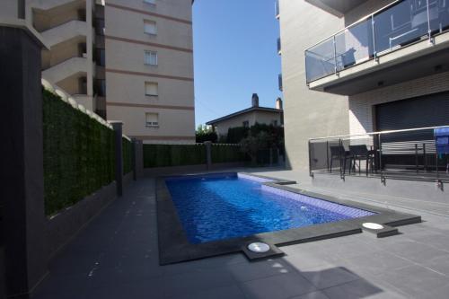 The swimming pool at or near InmoSantos Apartaments Nuria