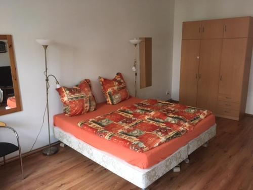 Postel nebo postele na pokoji v ubytování Apartmany Dvory