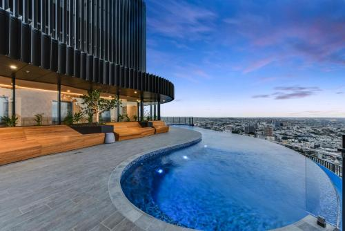 The swimming pool at or near Impressive River And City Views In CBD