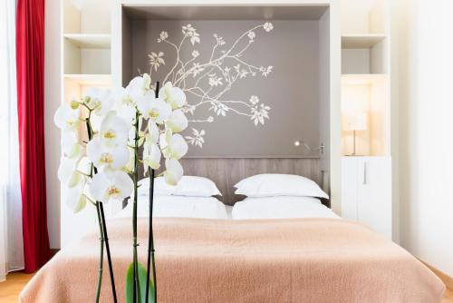A bed or beds in a room at Hapimag Resort Paris