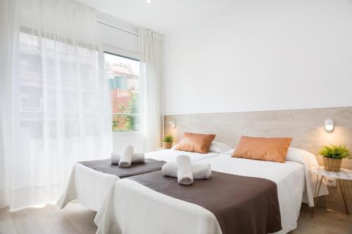 Postel nebo postele na pokoji v ubytování BcnStop Sagrada Familia