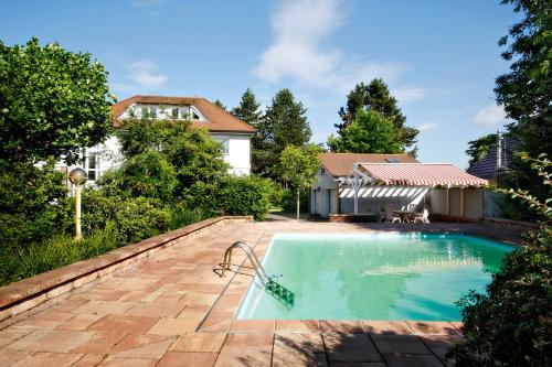 The swimming pool at or near Villa Spreewaldgarten