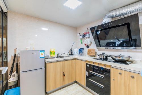 Кухня или мини-кухня в 千灯湖/金融高新区loft 公寓
