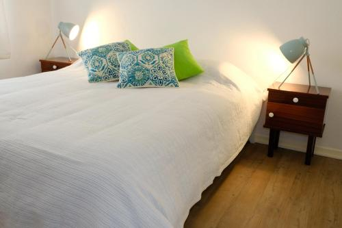 A bed or beds in a room at Vale Coelhos Casa de Campo