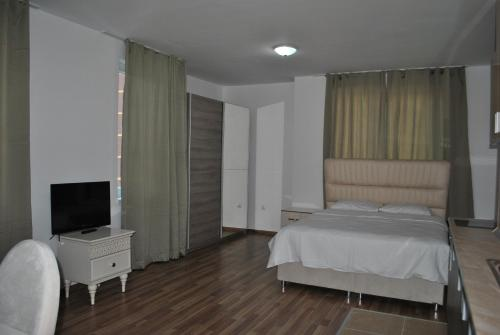 A bed or beds in a room at Villa Aria Private Apartments