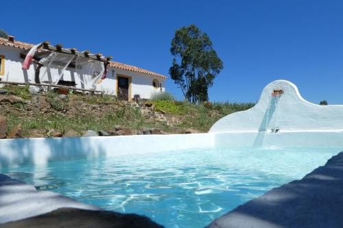 The swimming pool at or near O Monte da Ribeira-The Stream House