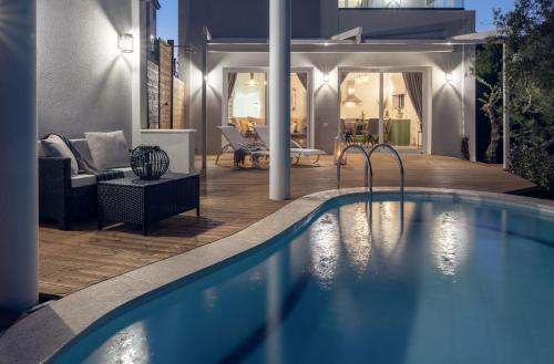 The swimming pool at or near Chris & Jo Villas