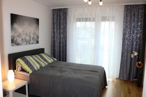 Łóżko lub łóżka w pokoju w obiekcie Komfort Apartments Alte Donau/Donauzentrum