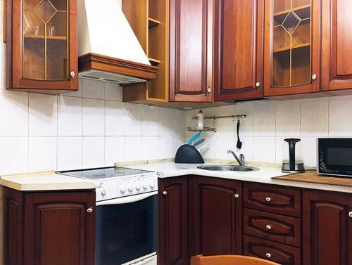 A kitchen or kitchenette at ApartLux Sviblovo