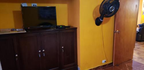 A television and/or entertainment center at Spacious Apartment in the Heart of Medellin