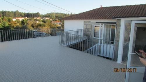 A balcony or terrace at Porto Airport Cosy House