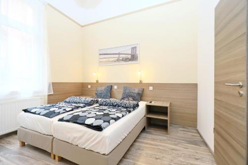 A bed or beds in a room at Vaci Apartments