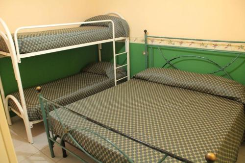 A bunk bed or bunk beds in a room at La Casetta