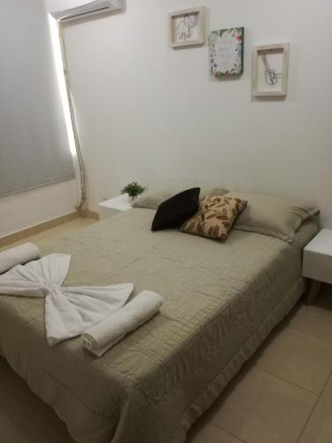 A bed or beds in a room at Apartamento Vacacional