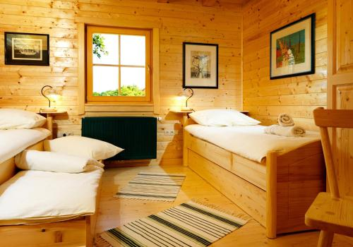 A bed or beds in a room at Farm Stay Pirc