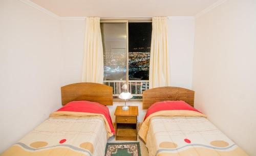 A bed or beds in a room at Apartamento en Condominio Mar Egeo