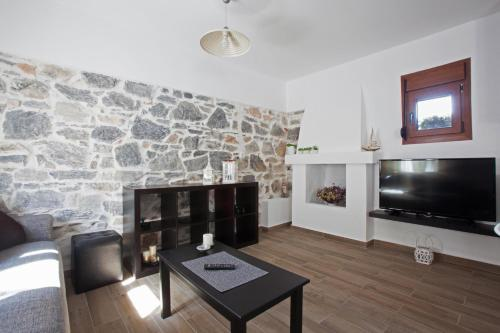 A television and/or entertainment center at Antoni's House Makri