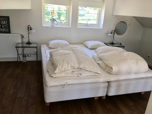 Säng eller sängar i ett rum på Bolodge Cottages