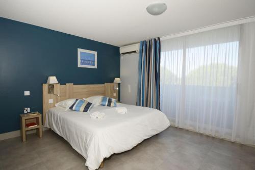 Un ou plusieurs lits dans un hébergement de l'établissement Résidence Odalys Aqualia