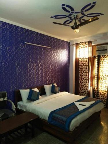 Ein Bett oder Betten in einem Zimmer der Unterkunft Airport Hotel Green Heights