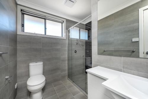 A bathroom at Taren Point beach house