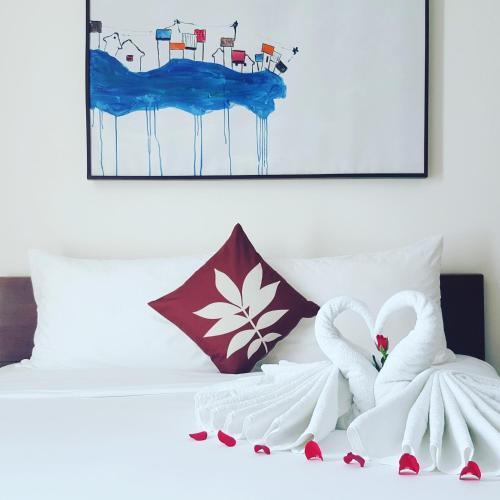 Un pat sau paturi într-o cameră la Lana Villa Hoi An