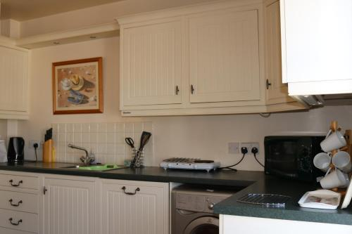 A kitchen or kitchenette at Saltpans Self Catering