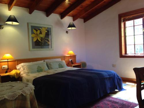 A bed or beds in a room at Finca des Weines