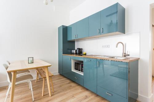 A kitchen or kitchenette at CMG Champ de Mars/ Grenelle