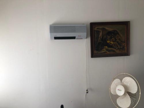 A television and/or entertainment center at Apartamento en Maldonado