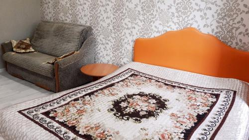 Кровать или кровати в номере Квартира в центре Пятигорска