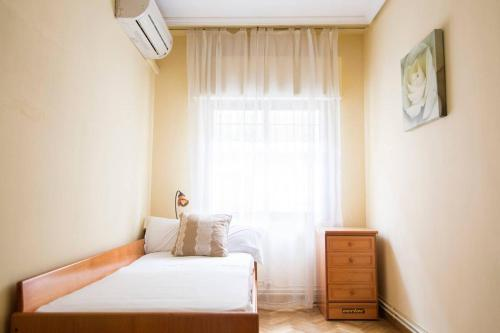 A bed or beds in a room at Home & Private Terrace WIFI + AIRCON