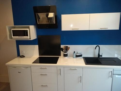 A kitchen or kitchenette at Appartement courte durée à Béthune