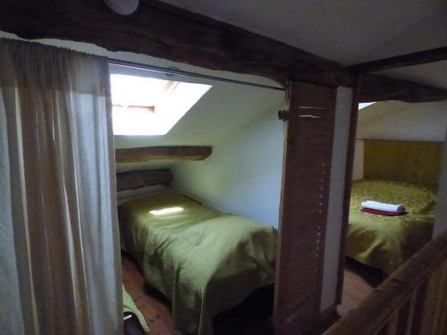 Un ou plusieurs lits dans un hébergement de l'établissement gite le marguerite