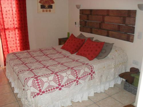 A bed or beds in a room at Los Lapachos
