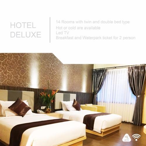 A bed or beds in a room at Sangkan Resort Aqua Park